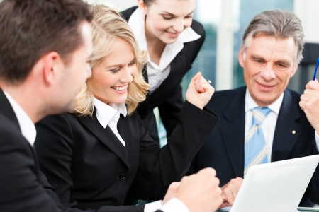 business consulting: Business - colleagues have a successful meeting in an office
