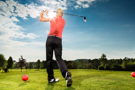 woman golf: Young female golf player on course doing golf swing, she presumably does exercise Stock Photo