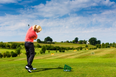 driving range: Young female golf player at Driving Range Stock Photo