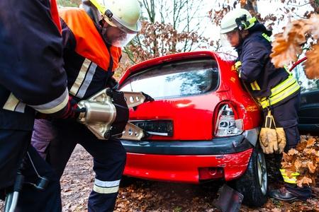 fire brigade: Accident - Fire brigade rescues accident Victim of a car using a hydraulic rescue tool