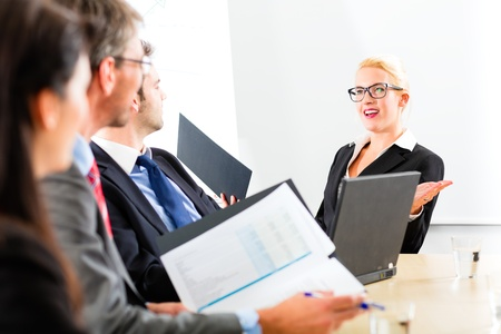 negotiate: Business - businesspeople have a meeting with presentation in office, they negotiate a contract