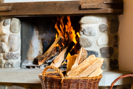 hunter's cabin: fire in a rustic fireplace in a traditional mountain hut Stock Photo
