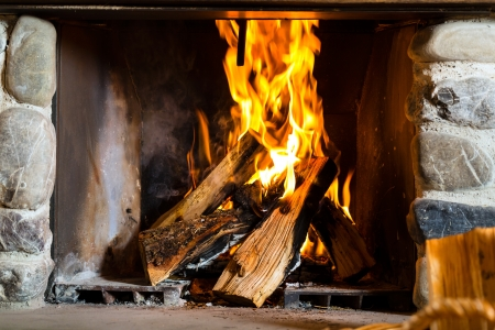 fire in a rustic fireplace in a traditional mountain hut Stock Photo - 21168691