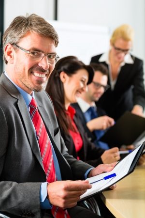 Business - businesspeople have a meeting with presentation in office, they negotiate a contract - Portrait of a businessman Stock Photo - 21401562