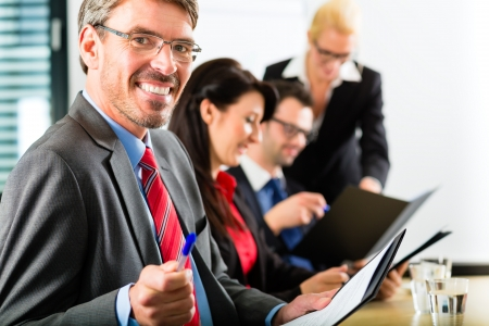 Business - businesspeople have a meeting with presentation in office, they negotiate a contract - Portrait of a businessman photo
