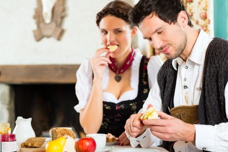 hunter's cabin: Couple in a traditional mountain hut having a meal