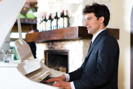 creates: Pianist on a piano creates a beautiful musical Atmosphere in a fine dining restaurant