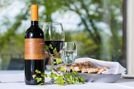 bred: Arrangement with wine bottle and bred in a fine dining restaurant