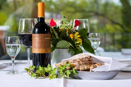 wine and food: Arrangement with wine bottle and bred in a fine dining restaurant
