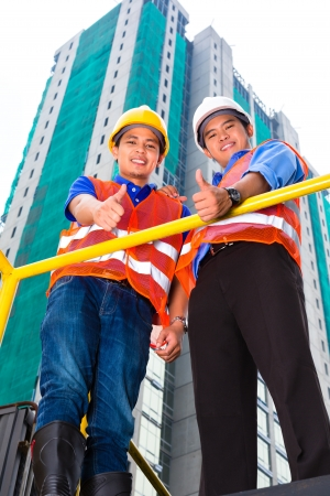 Chinese architect and supervisor on a construction site Stock Photo - 22046521