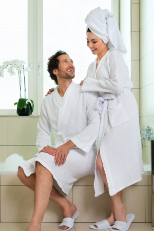 Young couple in bathroom of hotel making a bubble bath Stock Photo - 22046755