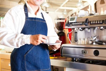 man drinking coffee: Coffeeshop - asian barista presents coffee in his shop