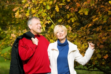 deeply: Mature couple deeply in love having a walk holding each other tight Stock Photo