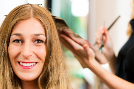 At the hairdresser - woman gets new hair colour or highlights photo