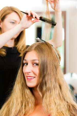 hair coloring: At the hairdresser - woman gets new hair colour or highlights Stock Photo