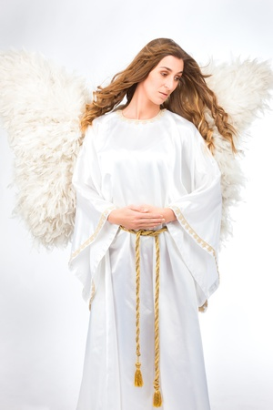 Woman in angel costume with artificial feather wings isolated on white background spirituality purity dreams religion Stock Photo