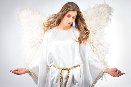white robe: Woman in angel costume with artificial feather wings isolated on white background spirituality purity dreams religion Stock Photo