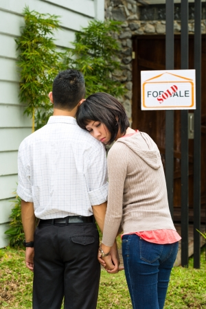 purchaser: Real estate market - young Indonesian couple looking for real estate apartment or house to rent or buy, they came too late, it is sold or leased