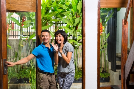 Real estate market - Young Indonesian couple moving in a home or apartment photo