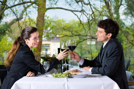 Businesspeople having business lunch in a fine dining restaurant photo