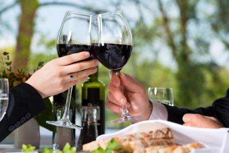 fine dining: Businesspeople having business lunch in a fine dining restaurant