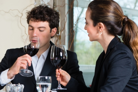 couple dining: Businesspeople having business lunch in a fine dining restaurant