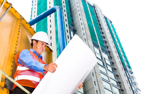 Chinese construction worker or supervisor or architect with clipboard on a building site in Asia Stock Photo - 22796698