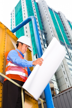 Chinese construction worker or supervisor or architect with clipboard on a building site in Asia Stock Photo - 22796711