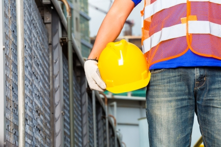 tallyman: Worker on construction site with helmet or hard hat
