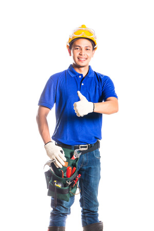 tallyman: Indonesian Asian builder or construction worker with helmet and  tool belt