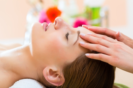 Wellness - woman receiving head or face massage in spa Stock Photo - 22880406