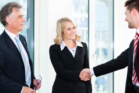 shaking hands: Business - Two businesspeople shaking hands