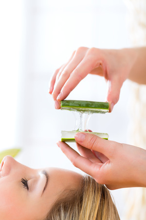 Wellness - woman receiving head or face massage whit aloe Vera in spa Stock Photo - 23512088
