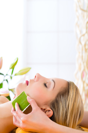 Wellness - woman receiving head or face massage whit aloe Vera in spa Stock Photo - 23512090