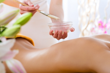 beauty therapist: Wellness - woman receiving body or back massage in spa Stock Photo