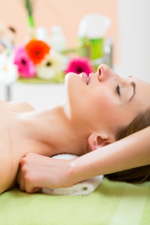Wellness - woman receiving neck or shoulder massage in spa photo