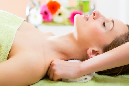 Wellness - woman receiving neck or shoulder massage in spa Stock Photo - 23760460