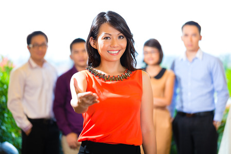 Asian Creative team - young businesspeople are successful with a project greeting a new team member Stock Photo