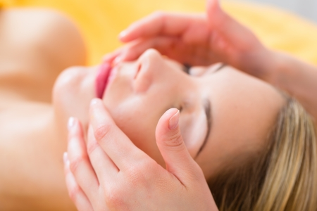 Wellness - woman receiving head or face massage in spa Stock Photo - 23964900