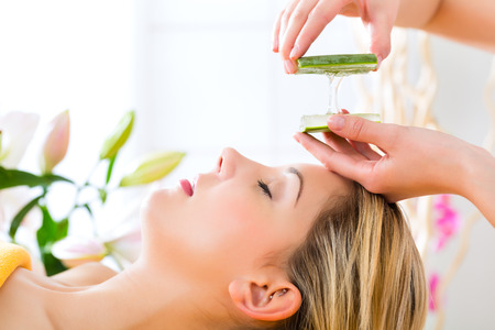 Wellness - woman receiving head or face massage whit aloe Vera in spa Stock Photo - 23964903