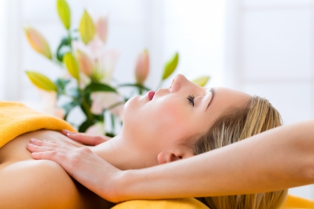 Wellness - woman receiving head or face massage in spa photo