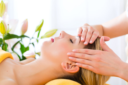Wellness - woman receiving head or face massage in spa Stock Photo - 23941431