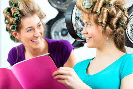 rag: women at the hairdresser reading a magazine or a rag and chit-chat, while your hair drying under a hairdryer