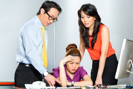 burn out: Asian Colleagues or coworker and manager discuss about or bullying or chicane stressed or anger employee with burn out or problems