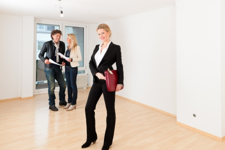 accommodation broker: Real estate market - young couple looking for real estate to rent or buy an apartment  Stock Photo