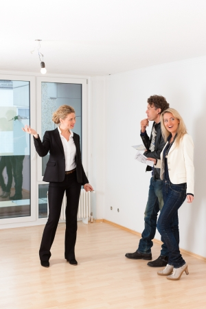 Real estate market - young couple looking for real estate to rent or buy an apartment Stock Photo - 24283613