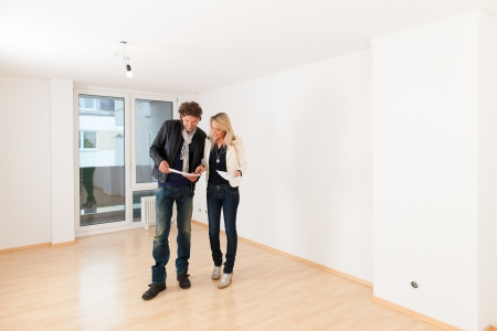 Real estate market - young couple looking for real estate to rent or buy an apartment  Фото со стока