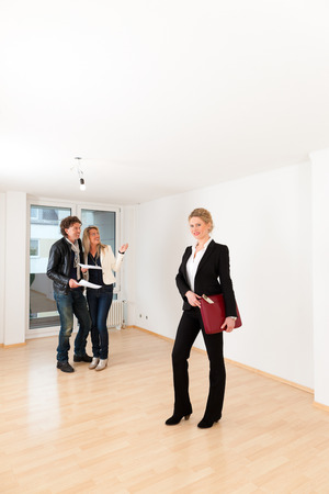 accommodation broker: Real estate market - young couple looking for real estate to rent or buy an apartment