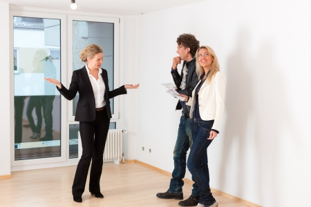 Real estate market - young couple looking for real estate to rent or buy an apartment photo