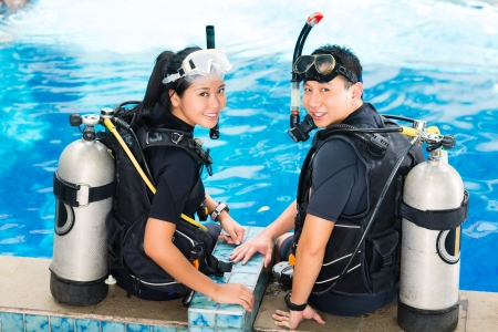 scuba woman: Asian people at the diver Course in diving school in wetsuit with an oxygen tank